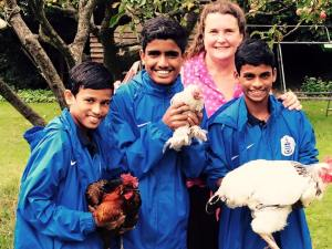 Sara Ward with QPR South Mumbai Soccer Challenge winners with chickens